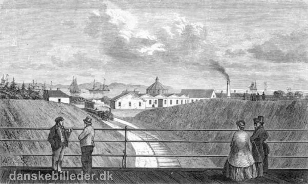 Udsigt fra Frederiksbroen mod Aahus Banegård i 1862.